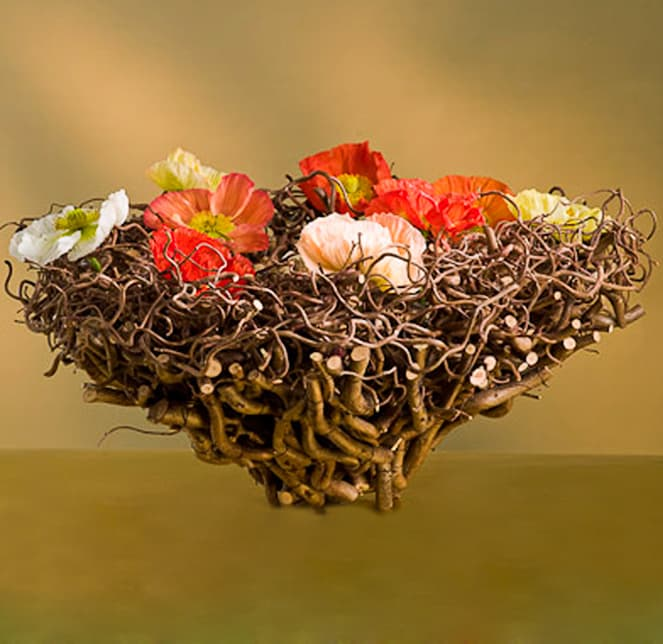 Beautiful conical container made from Corylus. Inside there are water tubes and all coloured papaver flowers.  Poppies are one of the most  beautiful spring flowers.