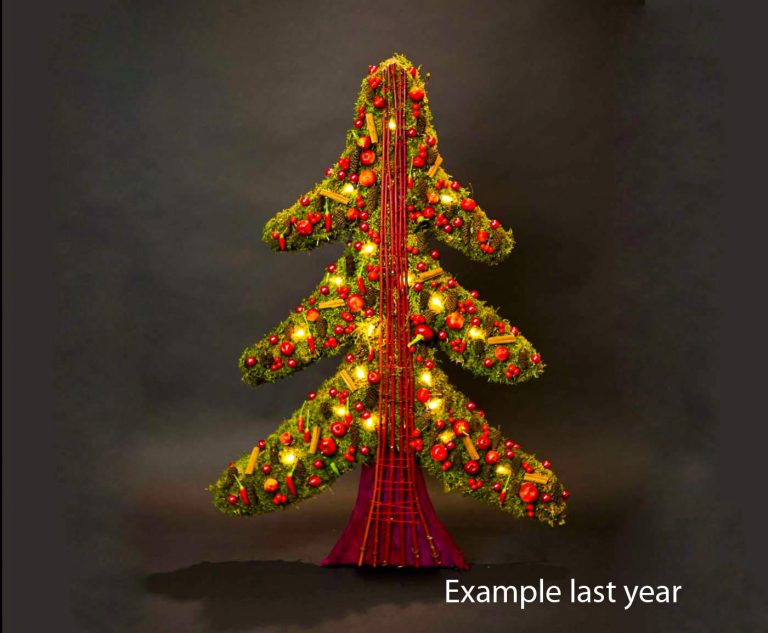 Alternative christmas tree made of green moss and red decoration