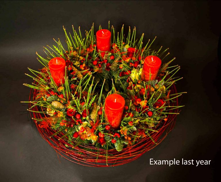 classic wreath with 4 red candles and typical decoration with a cornus collar